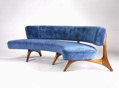 Floating Curve Sofa. Vladimir Kagan sculptured walnut wood base.  Designed in 1952