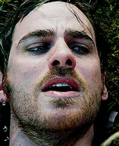 Killian Jones + touching his lips after being kissed by Emma Swan