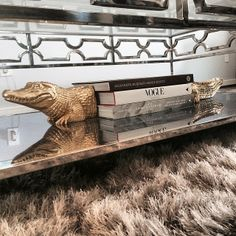 @Harman Kaur Pradhan added a little bit of gold whimsy to her Abigail Coffee Table with our Alligator Bookends.