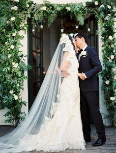 Bride & Groom Portrait from Erich McVey Photography -- Beautiful Wedding Veil -- See the wedding here: http://www.StyleMePretty.com/2014/04/08/organic-garden-affair-in-san-juan-capistrano/ erichmcvey.com -- #smp