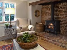 The cottage has a welcoming inglenook fireplace complete with cosy wood burner.