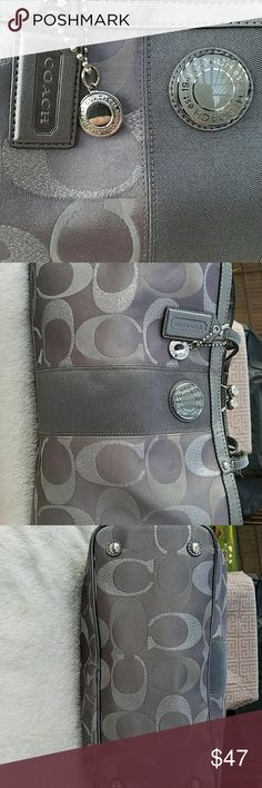 Coach Dark Grey With Light Grey/Metallic Purse This was MY very 1st Coach purchase❣ over 10 years ago. It is the traditional satin tri-color greys, C with leather trim, luggage tag, and silver Coach disc. This was A rare find and I am not hard on my purses, nor are they dirty. There are NO stains outside OR inside I can find. It boasts the large inside middle button closing, a large one side zipper compartment, and two additional pockets. Metal feet protectors. A bit of wear on the handle…
