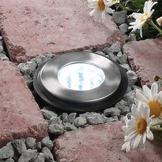 12V plug and play outdoor ground stainless steel light, weatherproof to IP68 meaning it can be submersed in water up to 0.50m, available at  http://www.qvsdirect.com/ for £24.95. With 2m cable to connect with transformer and 12x2W LED lamps. 3 year guarantee. H:115mm D:115mm Cut-out diameter: 90mm
