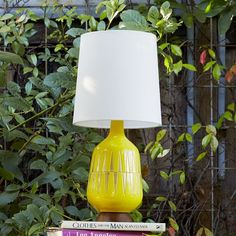 Hand painted in a mod yellow palette, the subtly textured, wood-based Mid-Century Ceramic Table Lamp's organic silhouette, bottle shape and geometric pattern is inspired by 1950s and '60s design.
