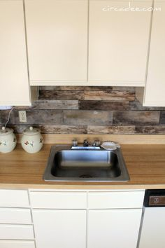 wood backsplash for kitchen. made from old pallets and attached with liquid nails!