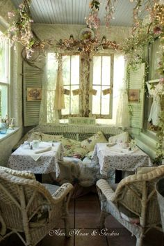 This is so beautiful and cozy. Can you imagine lunching, or taking tea, with friends on a porch like this?