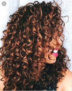 Highlights curly hair hot pink lipstick and white teeth worn by young woman with dark brunette Brown Curly Hair, Colored Curly Hair, Short Wavy Hair, Spiral Perm Long Hair, Spiral Perms, Ombre Curly Hair, Frizzy Hair, Highlights Curly Hair, Brown Hair With Highlights