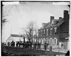 """Quarters of General Alfred Pleasonton, and """"Government Horse Shoeing Shop"""" at Left, 21st St. near F NW – Washington, D.C., April 1865"""