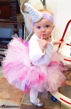 Grace: Emma Noelle is wearing this adorable unicorn costume! We love unicorns in our house, and they are Emma's favorite animal! I simply made the colorful tutu and got the horn...