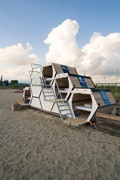 B-and-Bee stackable sleeping cells for festivalsThe B-and-Bee hexagonal sleeping cells each contain a king-size bed that can transform into a lounge seat, with storage space underneath.
