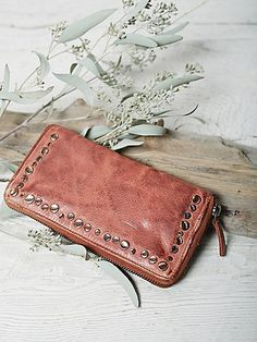 Tuscano Leather Wallet | Beautiful leather zip around long wallet with a zip closure and metal stud detailing.  Lined interior features one zip pocket, 12 card slots, and two bill slots.