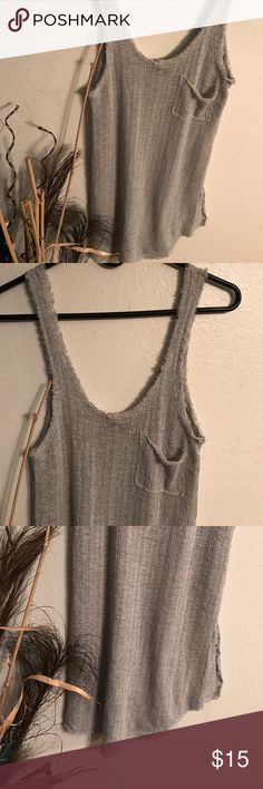 Ribbed  Grey Tank The everyday ribbed  grey tank. Very versatile. How to wear: with jeans Moto jacket and heels. Panama top. As a long to to paid with leggings. Love this top. New with tags. Boutique boutique Tops Tank Tops