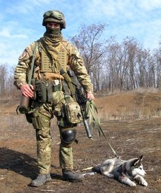 Ukrainian soldier with his pup