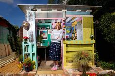 Shed: Ilona's Summerhouse aka The Beach Hut Location: North Lincolnshire Owned by Ilona Hand crafted by a first-time builder with recycled materials of pallets, doors, polycarbonate roof and reclaimed paving slabs, this shed is a little sunlit hideaway. 50 Sheds Of Grey, Pallet Platform Bed, Allotment Shed, Shed Images, Shed Of The Year, Cuprinol, Paving Slabs, Scrap Material, She Sheds