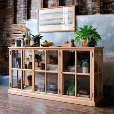 Light Oak 3 Door Glazed Door Sideboard from The Cotswold Company. Free Delivery & Free Returns. Oak & glass display sideboard, styled with house plants and books in a country home with a distressed textured wall.