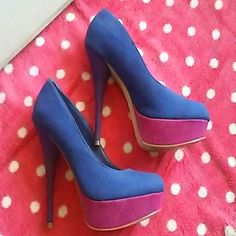 Brash platformed heels A vivid blue/purple and pink pair of heels. In good condition, a little bit of wear. High heels with additional platform under toe area. Shoes Heels