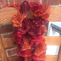 "Handmade knit ruffle scarf rust, burgundy, red Handmade knit ruffle scarf rust, burgundy, red with hint of sparkle approximately 72"" long width varies 1-5"" Handmade Accessories Scarves & Wraps"