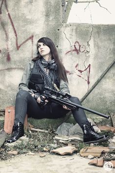 """Nathan sat on the brick against the wall.She looked really annoyed.""""First time we try to live a normal life and poof the war shows up again.""""She complained to the group.""""At least were fighting for are life,but I guess you want to die.""""Flynn insulted her bad.She rolled her eyes and fired her gun.""""How about that?""""She asked with sass.""""Not good enough.""""Flynn answered firing his gun 12 times."""