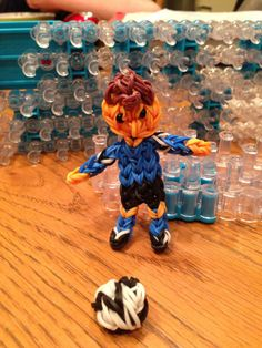 SOCCER PLAYER. Designed and loomed by Donna Lorber on the Rainbow Loom. (Rainbow Loom FB page)