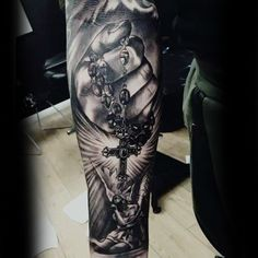 Christian Themed Sleeve Tattoo Cross And Rosary Beads For Guys