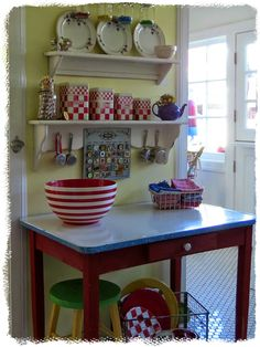 Art and Sand. Love the vintage enamel top table with all the cute things.