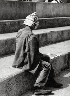 François-Marie Banier. | crown | paper | hat | newspaper | stairs | tired | blackandwhite