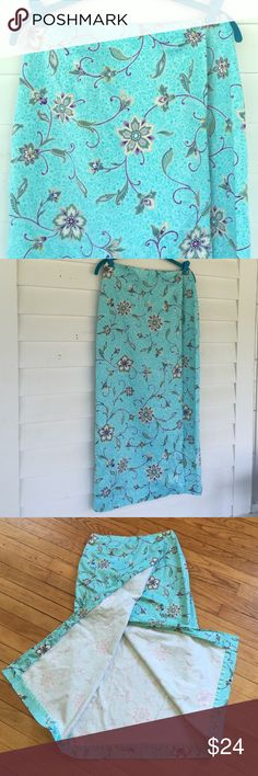 "Beautiful long Talbots wrap skirt, sz 8 Long minty green/blue floral wrap skirt from Talbots, size 8. Buttons inside the waistband. 97% cotton, 3% spandex. Waist: 29"". Length: 35"". In excellent used condition, no stains, marks, or tears. All items from a clean, smoke-free home. Please feel free to ask any questions or make an offer! Talbots Skirts Midi"