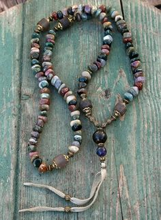Mala necklace made of 108, 6/7 x 10 mm - 0.236/0.276 x 0.394 inch, jasper gemstones and decorated with frosted smokey quartz and a jade guru bead - look4treasures on Etsy