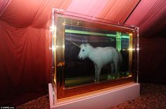A unicorn piece by Damien Hirst is just one of the many weird and wonderful artworks on display at Banksy's 'Dismaland'