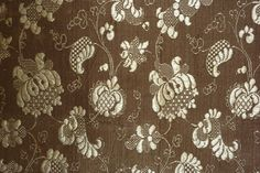 Brown Brocade c early 18th century Influenced by lace designs this hand loom narrow woven silk has a variety of leaf filings. Size: 21 1/2 x almost 16 1/2 in or 55 x 42 cm wide selvedge to selvedge Condition: very good. Three pin holes.