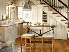 Check out the use of the space under the stairs.  Genius!!  A pretty cottage kitchen---LOVE