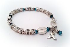 This lifetime bracelet is shown with an IN MEMORY bead, teal crystals, name, birthday date and passing date...