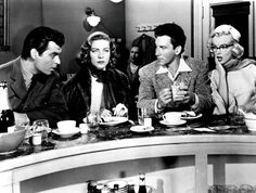 Rory Calhoun, Lauren Bacall, Cameron Mitchell and Marilyn Monroe in HOW TO MARRY A MILLIONAIRE (1953).