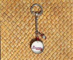 $7.  Unique key chain created from a used bottle cap and a cut out from an Atlanta Braves program guide.