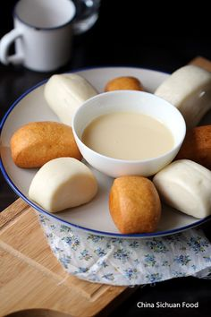 Fried Mantou with Condensed Milk - Chinese bun dough, fried or steamed, then dipped in condensed milk.