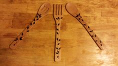 3 Pack of utensils Including:   -Serving Fork  -Slotted Serving Spoon  -Serving Spoon  Leaf and stem pattern burned into the wood. Dimensions: 12.125 in x 2.125 in x 1.125 in More options with spoons such as personalized handles at our store:  https://www.etsy.com/your/shops/100AcreForestCrafts
