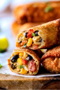 CRISPY Southwest Egg Rolls loaded with Mexican spiced chicken, beans, tomatoes, rice, avocado and cheese.