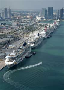 The Port of Miami, Florida used to be the largest cruise port in the world but has recently been overtaken by Port Everglades because the two largest ships in the world are deployed from there:  The Allure of the Seas and the Oasis of the Seas.