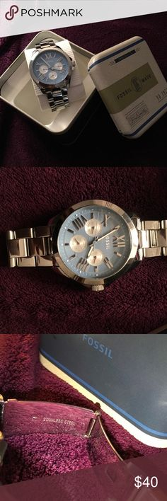 Silver stainless steel fossil watch for women! Silver stainless steel fossil watch! Dial is a baby blue color, the hour and minute hand glow in the dark also!! No scratches to the crystal, Excellent condition! Comes with extra links Incase adjustments are needed! Original packaging box! Fossil Jewelry Bracelets