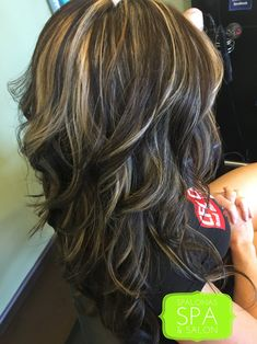 Rich dark neutral chocolate brown with blended highlights. A great way to camouflage gray new growth. www.spalonas.com