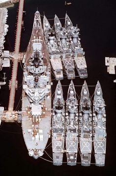 An aerial stern view of the decommissioned Battleship USS New Jersey and seven decommissioned Knox class frigates tied up at the Ship Intermediate Maintenance Facility at Puget Sound Naval Shipyard, WA., on 17 May Naval History, Military History, Cruisers, Us Battleships, Uss Iowa, Capital Ship, Us Navy Ships, Navy Military, Military Box