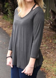 This is your classic black top with a twist. This Black Cut Neckline Top is flattering, simple, yet still unique with the cut neckline. It is the perfect item to wear in the winter with your favorite