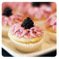 Blackberry Lemon Cupcakes-These look good. Reminded me of Sophia's first birthday cake. I made homemade blackberry buttercream frosting for it. It was really good.