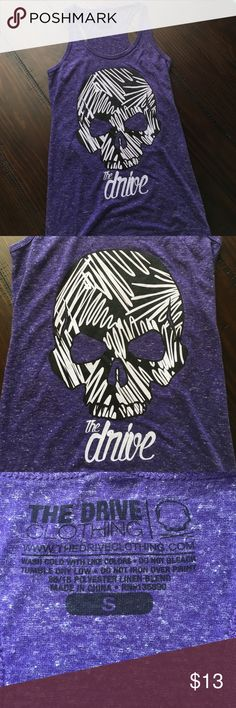 The Drive Clothing Purple 'Skull' Tank We symbolize your powerful mind through the use of the skull because everyone has a skull and has the drive within them. It is whether you use your skull and your drive to better yourself in life. Use your skull and think about what you want to do in life to have purpose; to make your mark in life; because you only have one. The Drive Clothing Tops Tank Tops