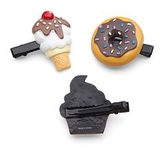 These Sweet Hair Clips ensure you'll have frosting and sprinkles in your hair whenever you want. A set of six, this pack contains two ice cream cones, two cupcakes, and two doughnuts - or, as we like to call it, lunch.