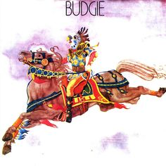 'Budgie' are a Welsh hard rock band from Cardiff. Budgie formed in 1967. Their original line-up consisted of Burke Shelley on vocals and bass, Tony Bourge on guitar and vocals, and Ray Phillips on drums. Budgie's music is often described as a cross between the progressive textures of Rush and the heaviness of Black Sabbath.