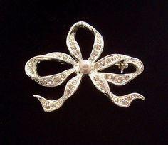 Sparkling Bow Pin with Clear Rhinestones & Imitation Pearl. https://www.rubylane.com/shop/elainesjewelry