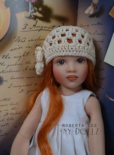 Cream Kish 4 Seasons crocheted cloche hat