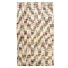 Cotton and wool rug with a chevron motif. Hand-woven in India.  Product: RugConstruction Material: Cotton and wo...