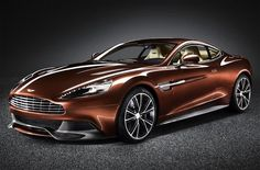 Aggressive, but delectable: First pictures of the new Aston Martin Vanquish    Read more: http://www.digitaltrends.com/cars/aggressive-but-delectable-first-pictures-of-the-new-aston-martin-vanquish/#ixzz1yRj1PYAt